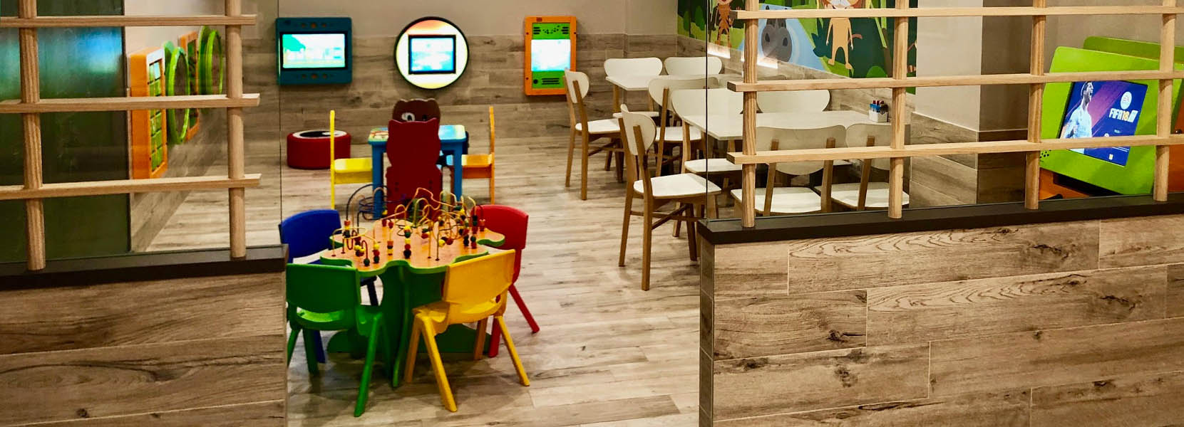 On this image you can see a kids' corner with kids' furniture
